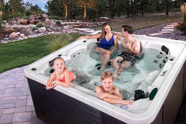 Family having fun in the hot tub