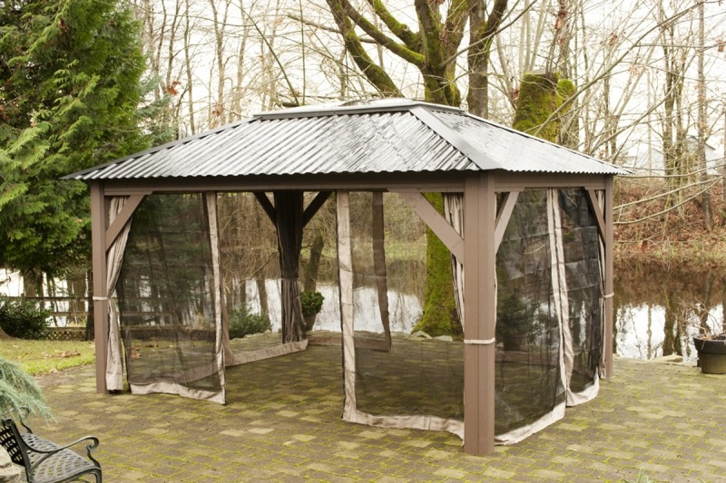 The side view of an open air Arctic Spas Gazebo with an almost closed insect screen , model Della