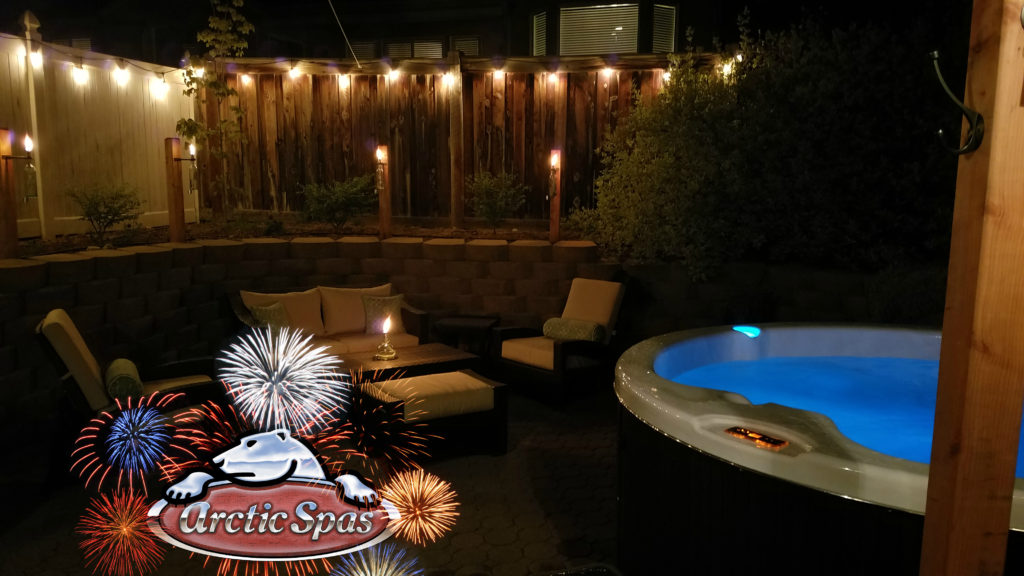 Arctic Spa in a backyard with fireworks