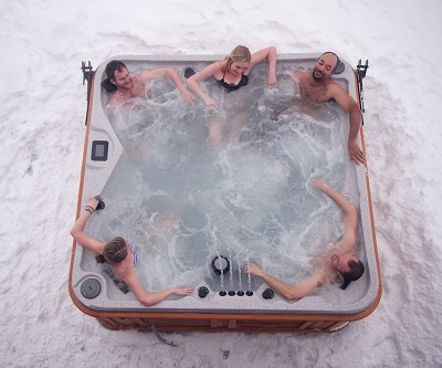 top view of a hot tub in winter with 5 people inside