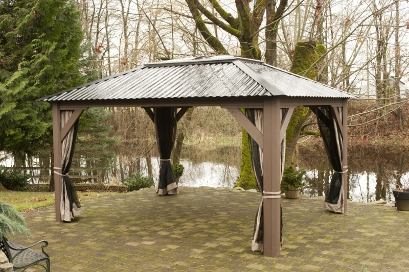 The side view of an open air Arctic Spas Gazebo, model Della
