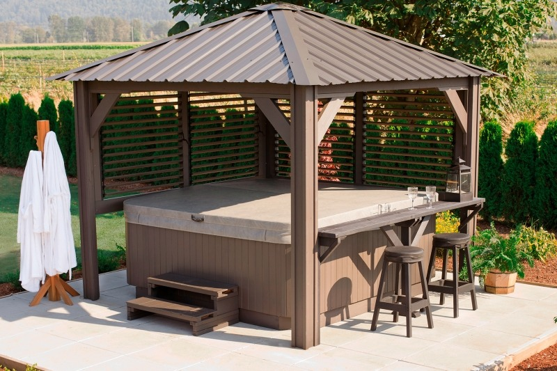 The side view of a Semi Enclosed Arctic Spas Gazebo Sienna with a hot tub