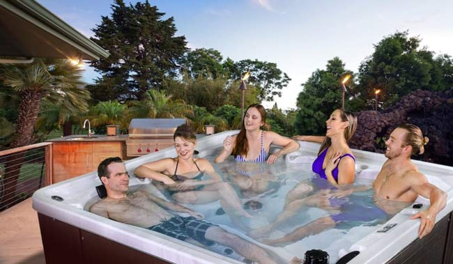 Friends chatting in a hot tub