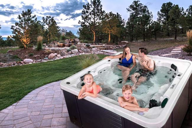 Family enjoying a hot tub.