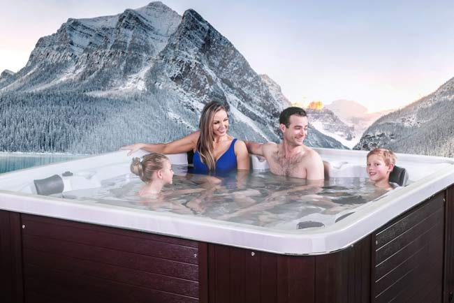 Family sitting in a hot tub.