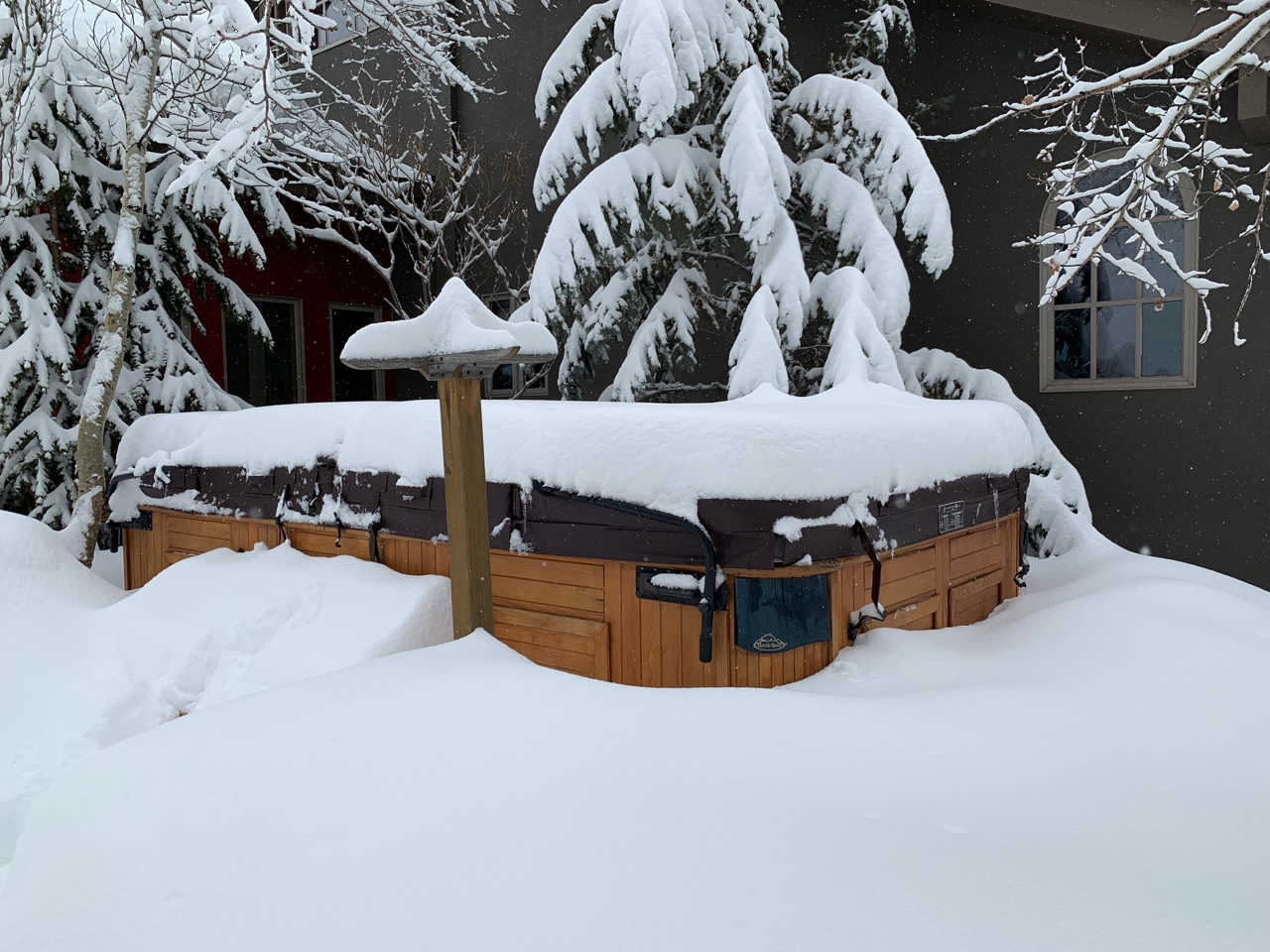 A hot tub under snow