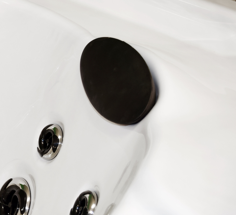 Side view of headrest fitted in a hot tub