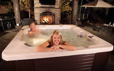 A couple relaxing in a Arctic Spas hot tub