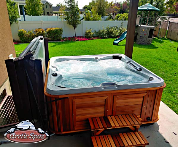 Peck's Arctic Spas Summit hot tub with a red cedar cabinet