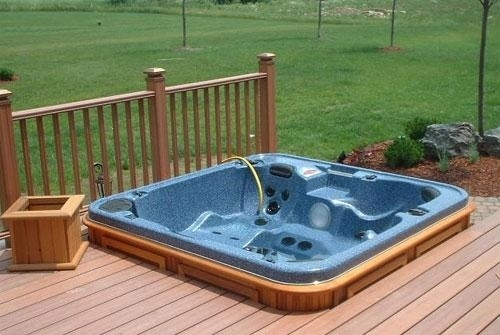 A hot tub build in into a porch