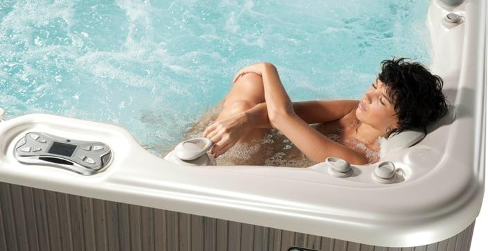 Arctic Spas mom relaxes in a hot tub