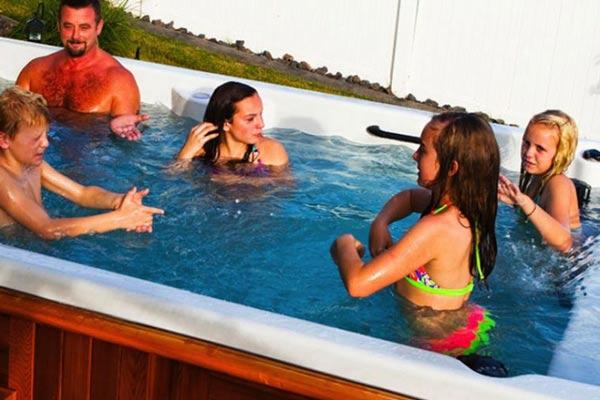 Family having fun in the Swim spa